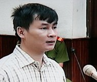 "Reporter and blogger Nguyen Van Hai speaks during the opening of his trial at Hanoi's people court in 2008. He and two other high-profile bloggers are currently awaiting trial in Ho Chi Minh City for ""propaganda against the state"""