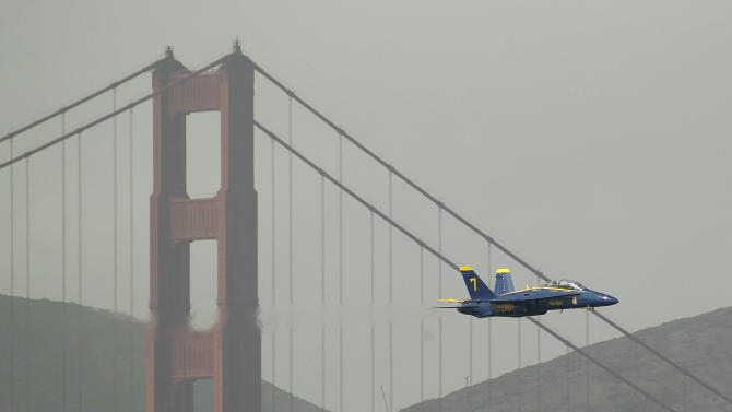 A Navy Blue Angels F/A-18 flies past the Golden Gate Bridge in San Francisco, Thursday, Oct. 4, 2012.  The Blue Angels were practicing for the annual Fleet Week celebration this weekend. (AP Photo/Eric Risberg)