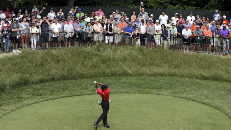 Tiger Woods tees off on the 18th hole during the fourth round of the U.S. Open golf tournament at Merion Golf Club, Sunday, June 16, 2013, in Ardmore, Pa. (AP Photo/Gene J. Puskar)