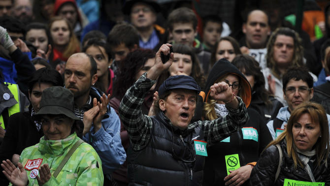 A demonstrator shouts slogans during the general strike in Pamplona, northern Spain on Thursday, May 30, 2013. People protest against the austerity measures and the strong economic crisis affecting the country with more than six million unemployed. Reading  (AP Photo/Alvaro Barrientos)