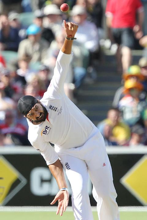 England's Monty Panesar bowls against Australia during their second Ashes cricket test match in Adelaide, Australia, Thursday, Dec. 5, 2013