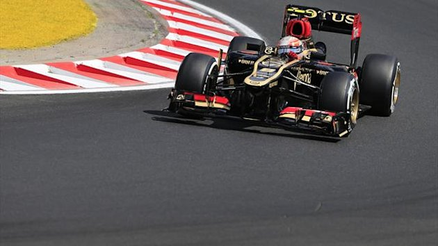 Lotus F1 Team's French driver Romain Grosjean drives during the second practice session at the Hungaroring circuit in Budapest on July 26, 2013 (AFP)