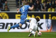Borussia Dortmund's Roman Weidenfeller (R) tackles Hoffenheim's Sven Schipplock during the German first division Bundesliga soccer match against Hoffenheim in Dortmund May 18, 2013. Hoffenheim won the match 2-1.  REUTERS/Ina Fassbender (GERMANY - Tags: SPORT SOCCER) DFL RULES TO LIMIT THE ONLINE USAGE DURING MATCH TIME TO 15 PICTURES PER GAME. IMAGE SEQUENCES TO SIMULATE VIDEO IS NOT ALLOWED AT ANY TIME. FOR FURTHER QUERIES PLEASE CONTACT DFL DIRECTLY AT + 49 69 650050