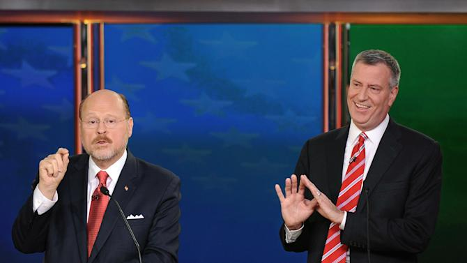 Republican candidate for New York City Mayor, Joe Lhota, left, makes a point as his Democratic rival Bill de Blasio gestures in his direction, during their final debate, Wednesday, Oct. 30, 2013 in New York. (AP Photo/Wall Street Journal, Peter Foley)