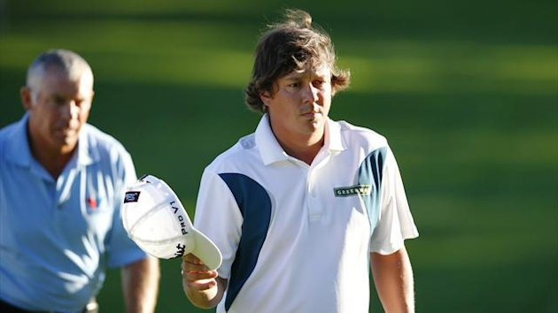 Jason Dufner (R) of the U.S. walks off the 18th green as Adam Scott's caddie Steve Williams walks behind during the third round of the 2013 PGA Championship golf tournament at Oak Hill Country Club in Rochester, New York August 10, 2013 (Reuters)
