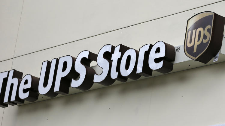 This Tuesday, Jan. 29, 2013,  photo, shows a UPS store in Hialeah, Fla.  United Parcel Service Inc. says it was slowed down in the fourth quarter  of 2012, by weak global trade and a disappointing holiday-shopping season.  (AP Photo/Alan Diaz)