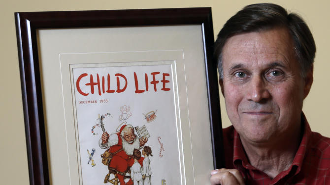 "Don Trachte of Bennington, Vt., poses with a1953 Child Life magazine cover illustration ""Santa's Helpers"" by Norman Rockwell for which he modeled, at the Bennington Museum on Friday, Sept. 28, 2012, in Bennington, Vt. Trachte is the child on the left.  (AP Photo/Mike Groll)"