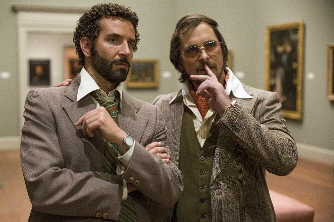 "This film image released by Sony Pictures shows Bradley Cooper, left, and Christian Bale in a scene from ""American Hustle."" (AP Photo/Sony - Columbia Pictures, Francois Duhamel)"