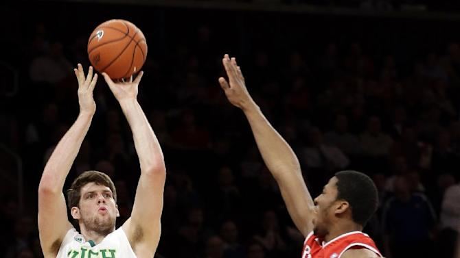 Notre Dame's Tom Knight (25) shoots over Rutgers' Kadeem Jack (22) during the first half of an NCAA college basketball game at the Big East Conference tournament, Wednesday, March 13, 2013, in New York. (AP Photo/Frank Franklin II)