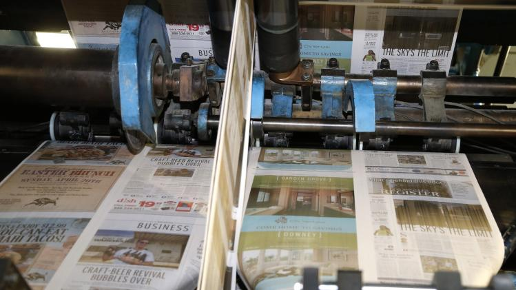 The first copies of the inaugural Los Angeles Register newspaper run off the presses in Santa Ana