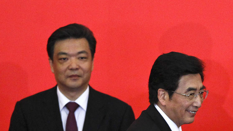 In this July 3, 2012 photo, Beijing mayor and newly-elected Beijing Municipal Communist Party Secretary Guo Jinlong, right, walks past vice mayor Ji Lin, back, during a press conference to introduce the city's top Communist Party leaders in Beijing, China. The People's Daily newspaper says Beijing's mayor and the vice mayor have resigned in what is likely a routine reshuffling but which comes amid public questioning of the government's handling of rainstorms that left at least 37 dead in the capital. (AP Photo/Alexander F. Yuan)