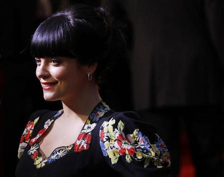 British singer Lily Allen poses as she arrives for the British premiere of Tamara Drew in Leicester Square