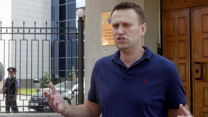 FILE - In this file photo taken on  Wednesday, June 13, 2012, anti-corruption blogger Alexei Navalny speaks to the media as he arrives for questioning at the headquarters of the Russian Investigation committee in Moscow, Russia. Oppositionist Alexei Navalny, who was elected in the Aeroflot Board of Directors, intends to protect the interests of this company and the rights of its minority shareholders. He has made an entry to this effect in his LiveJournal.(AP Photo/Misha Japaridze, file)