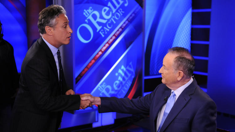 "FILE - In this Sept. 22, 2010 file photo, Comedy Central's Jon Stewart, left, and Bill O'Reilly tape an interview in New York. Stewart and  O'Reilly, a celebrity odd couple with a history of public political feuds, tangle in a sold-out debate in Washington. The so-called ""Rumble in the Air-Conditioned Auditorium"" offers a jocular sideshow to the series of three more somber debates this month between President Barack Obama and Republican Mitt Romney.  (AP Photo/Peter Kramer)"
