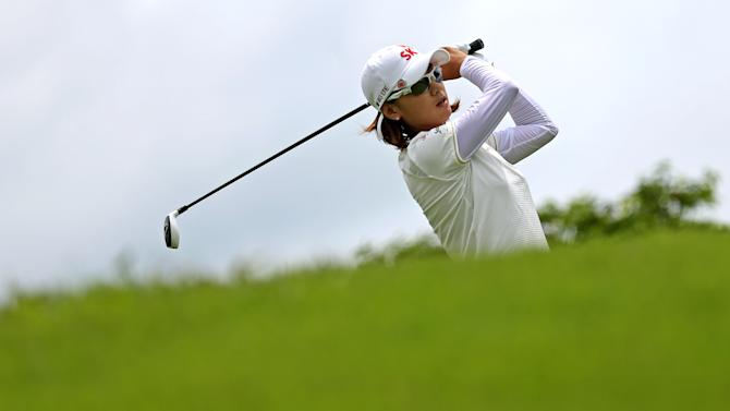 Na Yeon Choi of South Korea tees off on the 8th hole during the final round of the HSBC Women's Champions golf tournament Sunday, March 3, 2013, in Singapore.  (AP Photo/Wong Maye-E)
