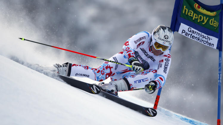 France's Alexis Pinturault passes a gate during the first run of an alpine ski, men's world cup giant slalom in Garmisch-Partenkirchen, Germany, Sunday, Feb. 24, 2013. (AP Photo/Shinichiro Tanaka)
