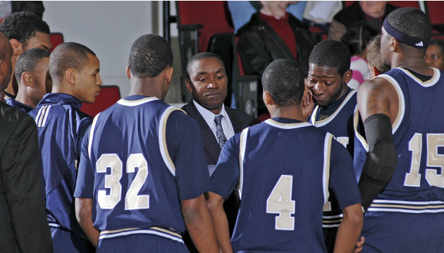 Florida International coach Isiah Thomas, center, talks to his players prior to an NCAA college basketball game against Troy in Troy, Ala., Thursday, Feb. 3, 2011. (AP Photo/The (Troy) Messenger, Thom
