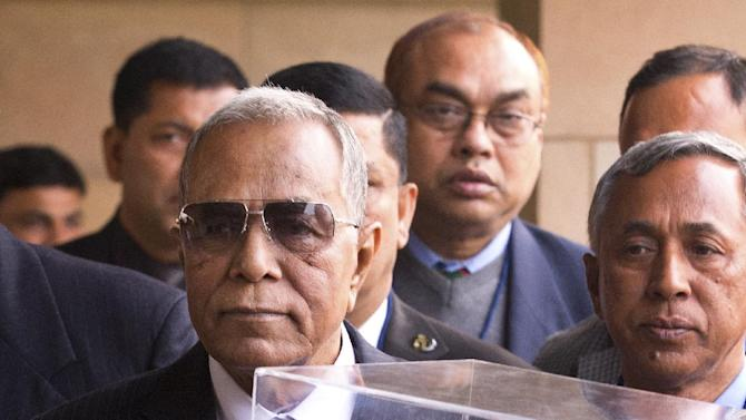 Bangladesh's President Abdul Hamid is presented with a bust of Mahatma Gandhi as he visits his memorial in New Delhi, India, Thursday, Dec. 18, 2014. Hamid is on a six-day visit to India. (AP Photo/Saurabh Das)