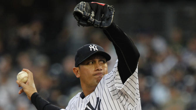 New York Yankees' Freddy Garcia delivers a pitch during the first inning of an interleague baseball game against the New York Mets, Friday, May 20, 2011, at Yankee Stadium in New York. (AP Photo/Frank Franklin II)