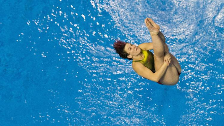 Second placed Germany's Nora Subschinski, top, and Tina Punzel compete in the women's synchronized 3m springboard final at the LEN Swimming European Championships in Berlin, Germany, Saturday, Aug. 23, 2014. (AP Photo/Gero Breloer)
