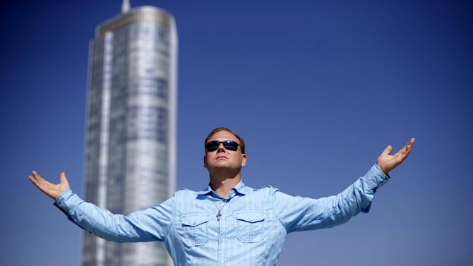 Daredevil Nik Wallenda poses for a portrait on the roof of the Leo Burnett Building in downtown Chicago, Wednesday, Sept. 17, 2014. Wallenda said his next tightrope walk will be more than 50 stories high from one high-rise building to another over the Chicago River. Wallenda, 35, will attempt the feat on Nov. 2, 2014. (AP Photo/Charles Rex Arbogast)