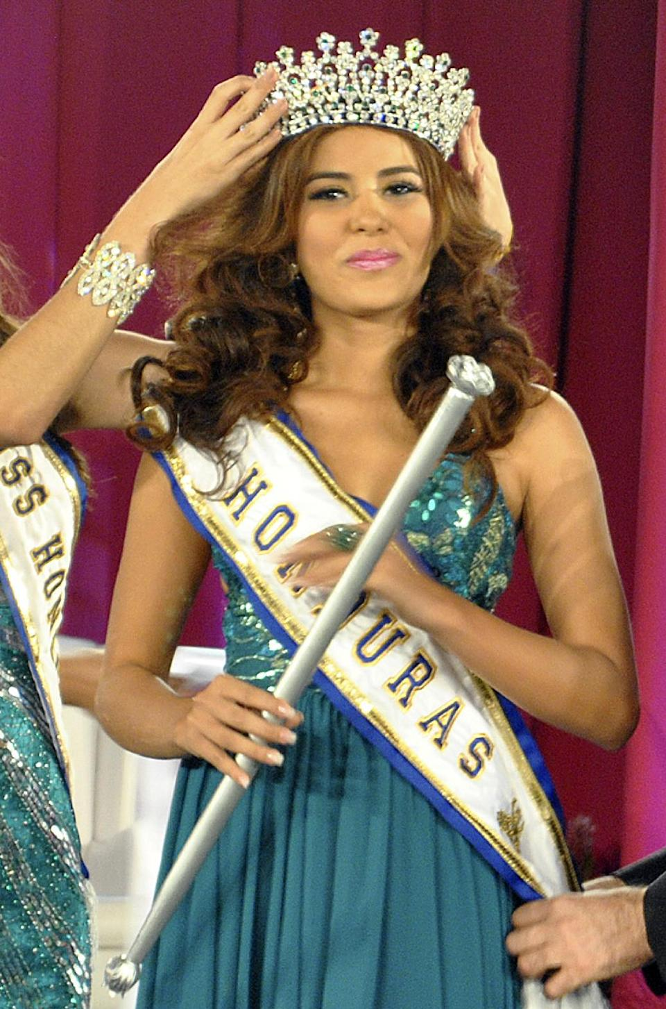 In this April 26, 2014 photo, Maria Jose Alvarado is crowned the new Miss Honduras in San Pedro, Sula, Honduras. Alvarado, and her sister Sofia...