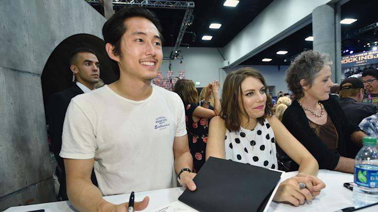 "IMAGE DISTRIBUTED FOR AMC - Steven Yeun, and from left, Lauren Cohan and Melissa McBride attend AMC's ""The Walking Dead"" autograph signing on Day 2 of Comic-Con International on Friday, July 25, 2014, in San Diego. (Photo by John Shearer/Invision for AMC/AP Images)"