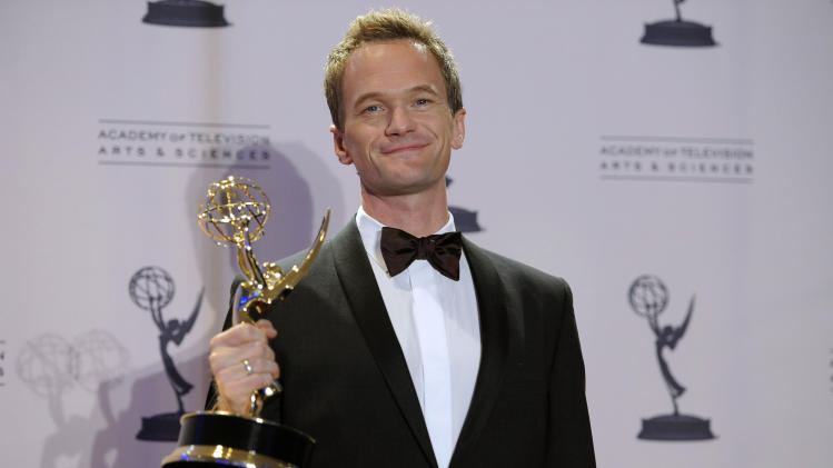 Neil Patrick Harris poses backstage with the award for outstanding special class programs for the 65th Annual Tony Awards at the 2012 Creative Arts Emmys at the Nokia Theatre on Saturday, Sept. 15, 2012, in Los Angeles. (Photo by Chris Pizzello/Invision/AP)