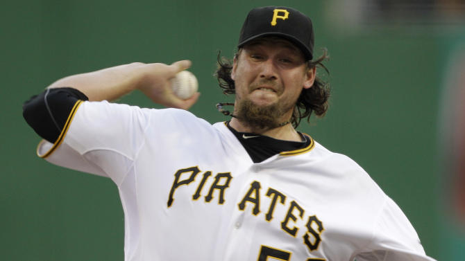 In this July 7, 2012, photo, Pittsburgh Pirates closer Joel Hanrahan delivers during the ninth inning of a baseball game against the San Francisco Giants in Pittsburgh. A person familiar with the talks says the Pirates and the Boston Red Sox are close to completing a trade that would send Hanrahan to Boston for a handful of prospects. Pittsburgh would ship Hanrahan and another player to the Red Sox in exchange for four players, (AP Photo/Gene J. Puskar)