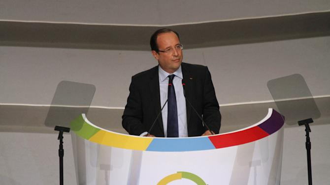French President Francois Hollande speaks during the opening session of the Francophonie Summit, in Congo, Kinshasa, Saturday, Oct. 13, 2012. Hollande is taking part in a summit of French-speaking countries, after months of controversy surrounding his visit to the vast Central African nation. He initially threatened not to attend but ultimately confirmed his participation in July, saying he wants to break away from the traditional paternalistic ways of France toward Africa. (AP Photo/John Bompengo)