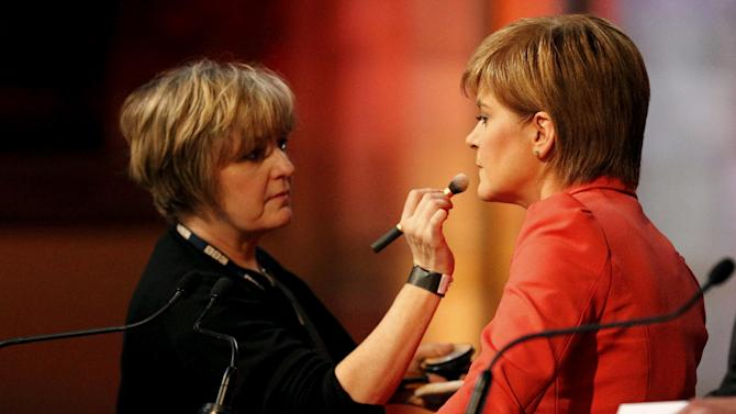 Nicola Sturgeon leader of the Scottish National Party has final touches of make up applied before taking part in the BBC Scotland leaders' debate in Edinburgh, Scotland