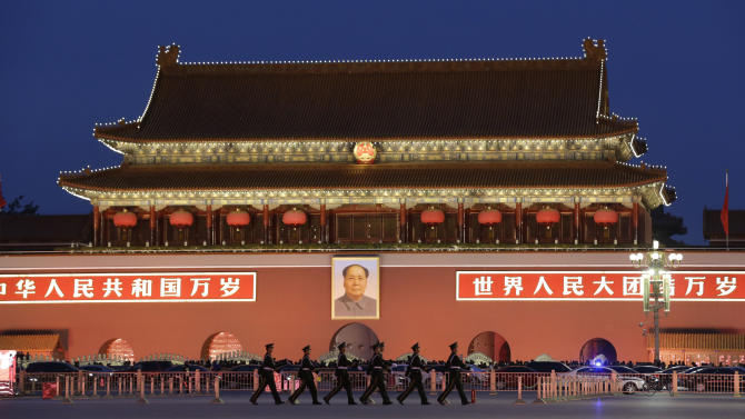 Chinese paramilitary policemen march at Tiananmen Square in Beijing, China, Wednesday, Nov. 7, 2012. The Chinese Communist Party's 18th National Congress is scheduled to begin Thursday, Nov. 8 in the Chinese capital. The once-a-decade event installs a new leadership to run the world's second largest economy and newly assertive global power. (AP Photo/Lee Jin-man)