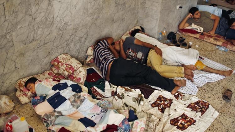 Palestinians, who fled their homes during heavy Israeli shelling in the Shejaia neighbourhood, sleep at the Saint Porfirios church in Gaza City