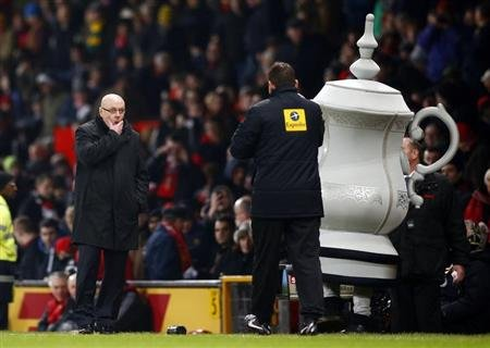 Reading's manager Brian McDermott rubs his face as he watches from the touchline during their FA Cup soccer match against Manchester United at Old Trafford in Manchester
