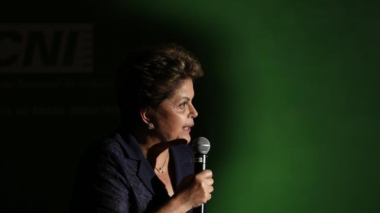 Brazil's President and presidential candidate Rousseff speaks during news conference after meeting at CNI headquarters in Brasilia