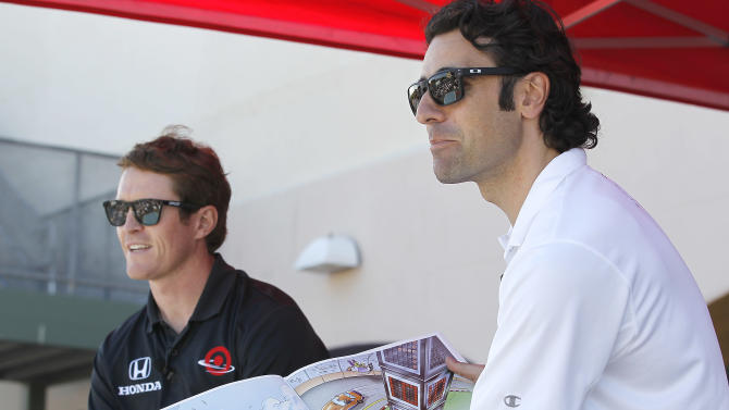 COMMERCIAL IMAGE -Dario Franchitti, right, and Scott Dixon, Target Chip Ganassi Racing IZOD IndyCar Series champions, read to students at Sanchez Elementary School during an assembly on Thursday,  Aug 23, 2012 in San Francisco. As part of the event, Dario Franchitti and Scott Dixon read to the children and presented a book donation and school supplies to the students on behalf of Target. This event is part of Target's commitment to education in San Francisco and in local communities across the country. Through programs such as this one, the company is on track to reach a total of $1 billion in giving to education, with a focus on reading, by the end of 2015.  (Tony Avelar /AP Images for Target)
