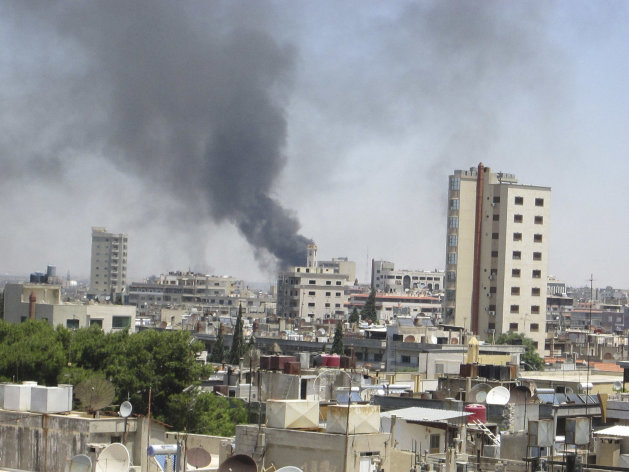 In this image made available on Tuesday June 12, 2012 smoke rises from a residential area of Talbisah in Homs city Syria Saturday June 9, 2012. (AP Photo/David Manyua/United Nations )