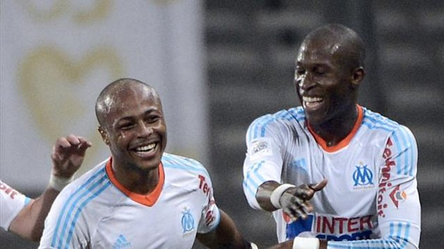Rod Fanni and Jordan Ayew celebrate Marseille&#39;s winner against Valenciennes