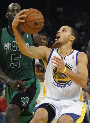Golden State Warriors' Stephen Curry looks up to shoot in front of Boston Celtics' Kevin Garnett (5) during the second half of an NBA basketball game in Oakland, Calif., Saturday, Dec. 29, 2012. (AP Photo/George Nikitin)