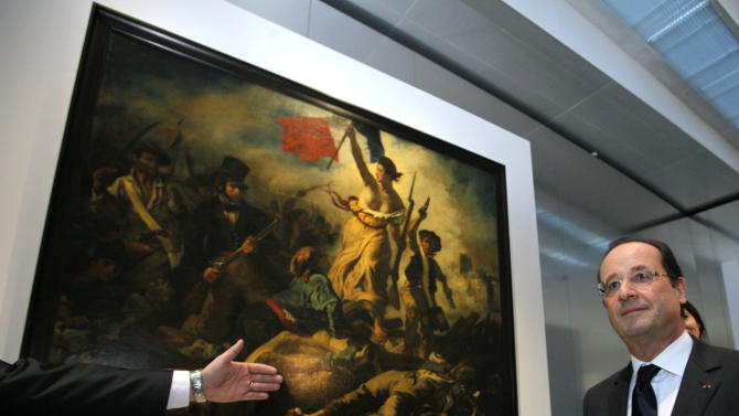 "France's President Francois Hollande is seen in front of "" La Liberte Guidant le Peuple"", a painting by Eugene Delacroix during the inauguration of the Louvre Museum in Lens, northern France, Tuesday, Dec. 4, 2012. The museum in Lens is to open on Dec. 12, as part of a strategy to spread art beyond the traditional bastions of culture in Paris to new audiences in the provinces. (AP Photo/Michel Spingler, Pool)"