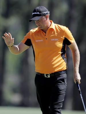 Peter Hanson, of Sweden, waves after his birdie on the eighth green during the third round of the Masters golf tournament Saturday, April 7, 2012, in Augusta, Ga. (AP Photo/Darron Cummings)