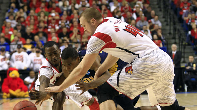 North Carolina A&T guard Lamont Middleton, center, has the ball stolen by Louisville guard Russ Smith (2), left, and forward Stephan Van Treese (44) during the second half  their second-round NCAA college basketball tournament game on Thursday, March 21, 2013, in Lexington, Ky. Louisville won 79-48. (AP Photo/James Crisp)