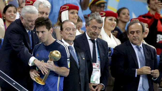 Argentina's Lionel Messi walks away after receiving the Golden Ball trophy following Germany's 1-0 victory over Argentina after the World Cup final soccer match between Germany and Argentina at the Maracana Stadium in Rio de Janeiro, Brazil, Sunday, July 13, 2014