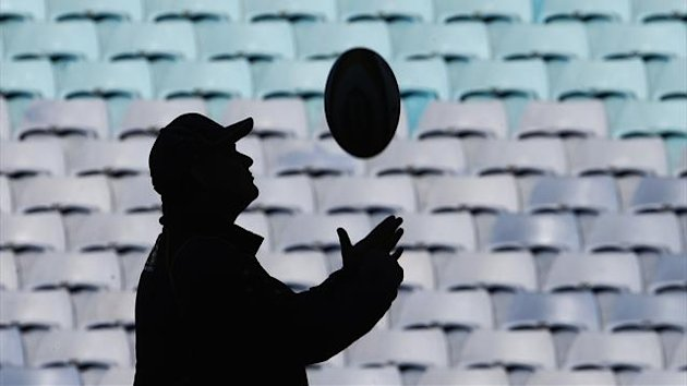 Australian Wallabies head coach Ewen McKenzie is silhouetted as he catches a ball during his team's captain's run in Sydney (Reuters)