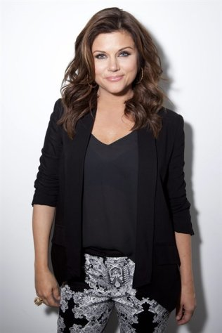 This Feb. 6, 2013 photo shows actress Tiffani Thiessen posing for a portrait in New York. Thiessen, best known for her former role as Kelly Kapowski on TV&#39;s &quot;Saved by the Bell,&quot; says she had no idea at the time of how popular the show was. She says she&#39;s grateful she grew up in the limelight before TMZ and other 24 hour media outlets and gossip blogs came along. She currently stars in the USA series &quot;White Collar.&quot; (Photo by Amy Sussman/Invision/AP)