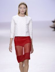 A model presents a sheer creation by Giambattista Valli during the Spring/Summer 2013 ready-to-wear collection show on October 1, 2012 in Paris