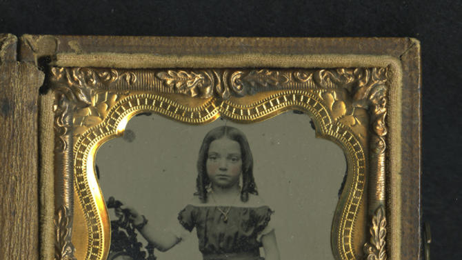 This image provided by the Museum of the Confederacy shows an Ambrotype image of an unidentified child that was found by Confederate Private Thomas W. Timberlake of Co. G, 2nd Virginia Infantry. Timberlake found this child's portrait on the battlefield of Port Republic, Virginia, between the bodies of a Confederate soldier and a Federal Soldier.  The Museum of the Confederacy is publicly releasing eight images recovered on battlefields of unidentified persons in the admittedly remote chance a descendant might recognize a facial resemblance or make a connection the battlefields where they were found. (AP Photo/The Museum of the Confederacy)