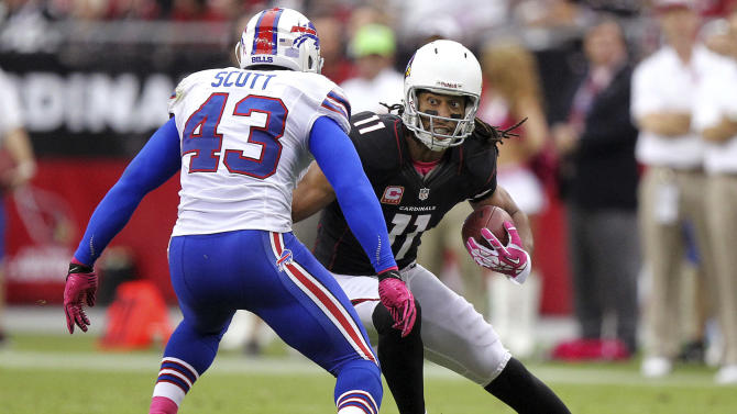 Arizona Cardinals wide receiver Larry Fitzgerald (11) looks to run after the catch as Buffalo Bills linebacker Bryan Scott (43) defends during the second half of an NFL football game, Sunday, Oct. 14, 2012, in Glendale, Ariz. (AP Photo/Paul Connors)