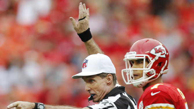 Referee Bill Leavy checks with other officials along side Kansas City Chiefs quarterback Matt Cassel (7) during the first half of an NFL football game against the San Diego Chargers at Arrowhead Stadium in Kansas City, Mo., Sunday, Sept. 30, 2012. (AP Photo/Ed Zurga)