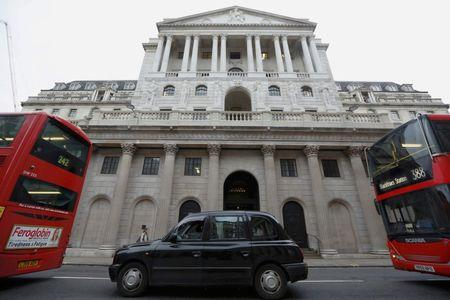 A taxi and buses queue outside the Bank of England in London, Britain